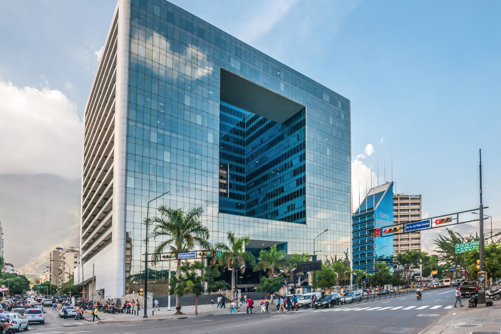 The glistening Parque Cristal, an 18-story office building located in Caracas. Source: Wikipedia
