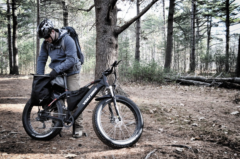 An ebike's lack of cargo capacity can be boosted with panniers. The author rigged up some waterproof Arkel Dry-Lites saddlebags to hold his vital gear.